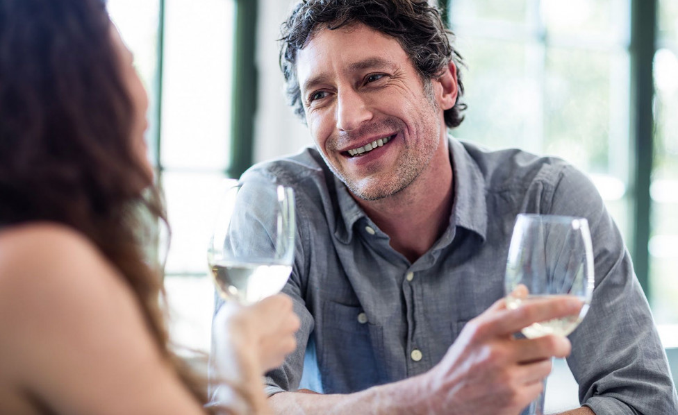 Couple having a conversation with wine Inset