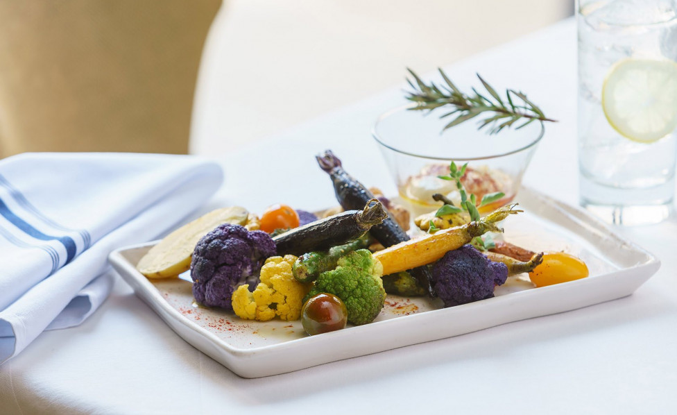 Savor the myriad of food options in our Luxe Club. Inset