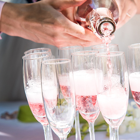 Rose wine being poured into glasses