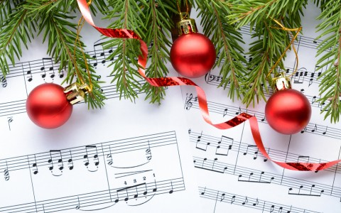 holiday sheet music with christmas ornaments