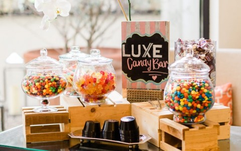 luxe candy bar table set up with candy jars