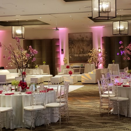 white round tables in event space with dance floor