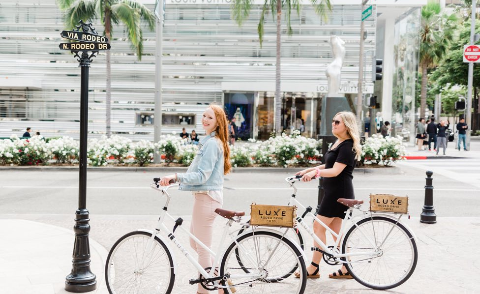two girls on luxe rodeo bikes on rodeo drive
