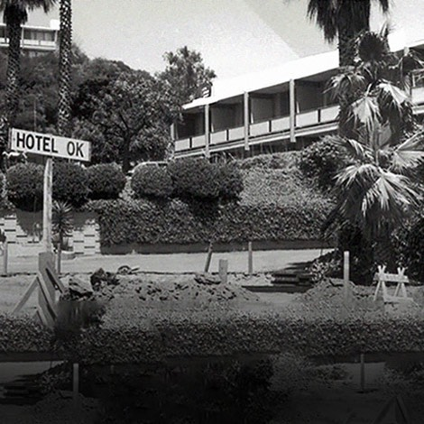 black and white image of hotel under construction
