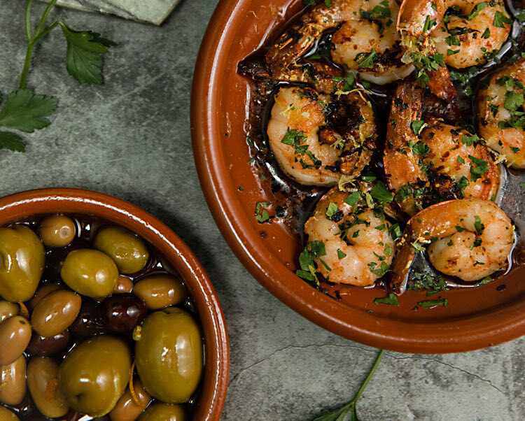 debajo new york olives and shrimp dish
