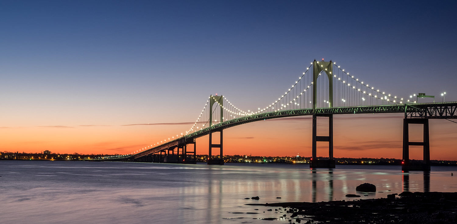 Bridge in Newport with sunset in the background