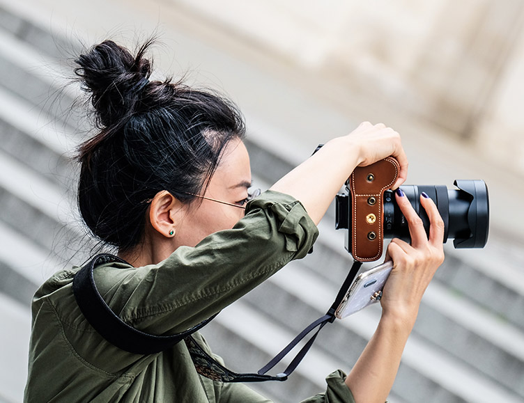 a photographer taking a photo with her professional camera