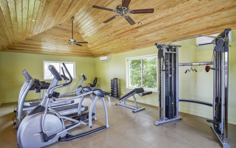 Fitness center with workout machine & ceiling fans