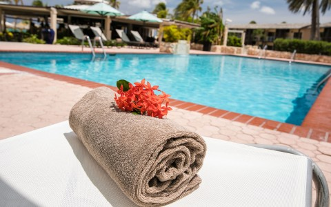 Rolled up towel by the pool