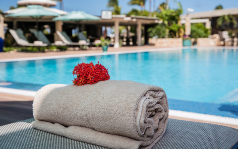 close up of towel rolled near pool
