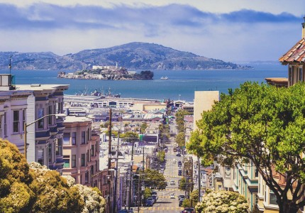 view of lombard street with view of the bay and alcatraz in the background