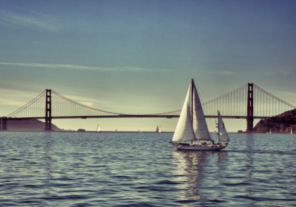 sail boats in the san francisco bay with the golden gate bridge in the background