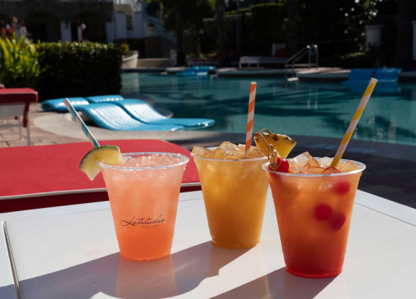 colorful drinks on table by the pool