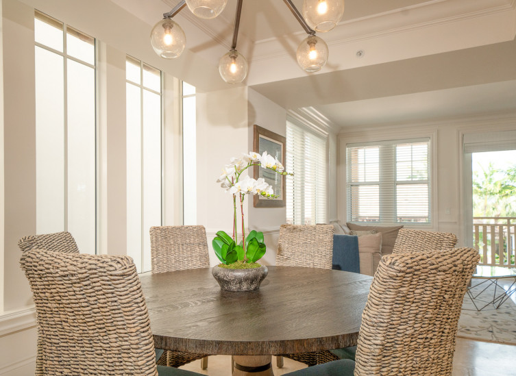 close up of dining table with wicker chairs