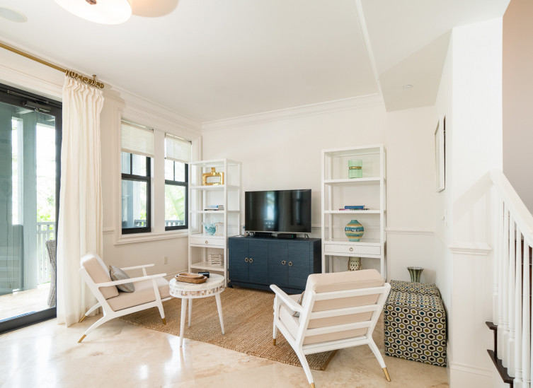Living space with casual style beach chairs, blue and white furniture and tv