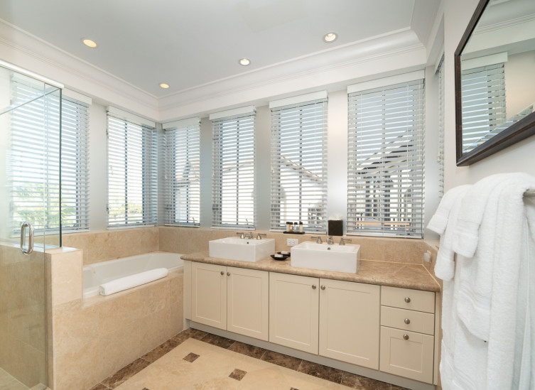 Full bathroom with vanity, tub and glass door shower
