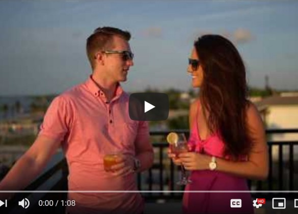 video image of couple enjoying a drink on the balcony of a vacation home