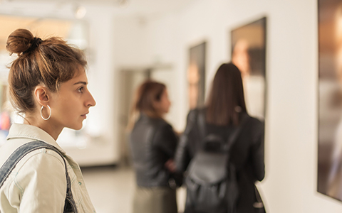 Woman looking at piece in museum
