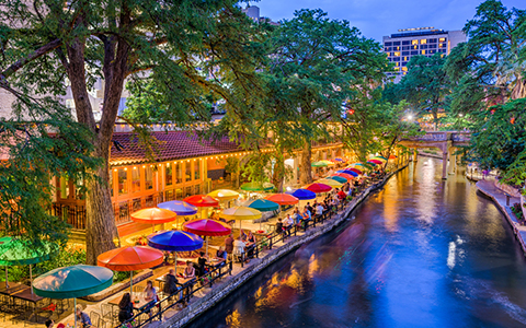 riverwalk at night with colorful umbrellas