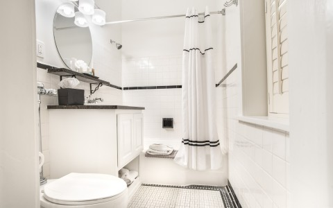 a white bathroom with large shower