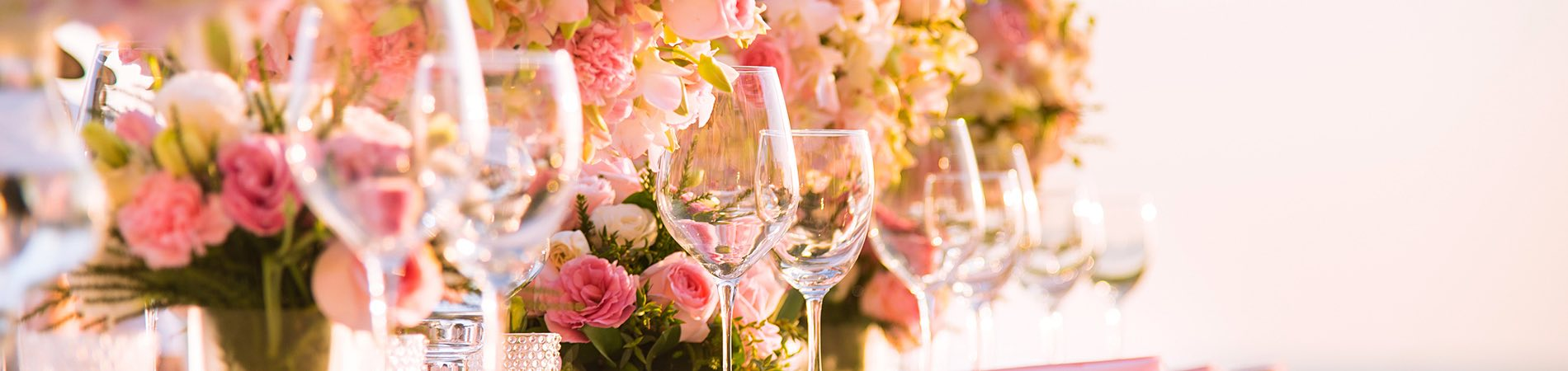two glasses and a floral arrangement