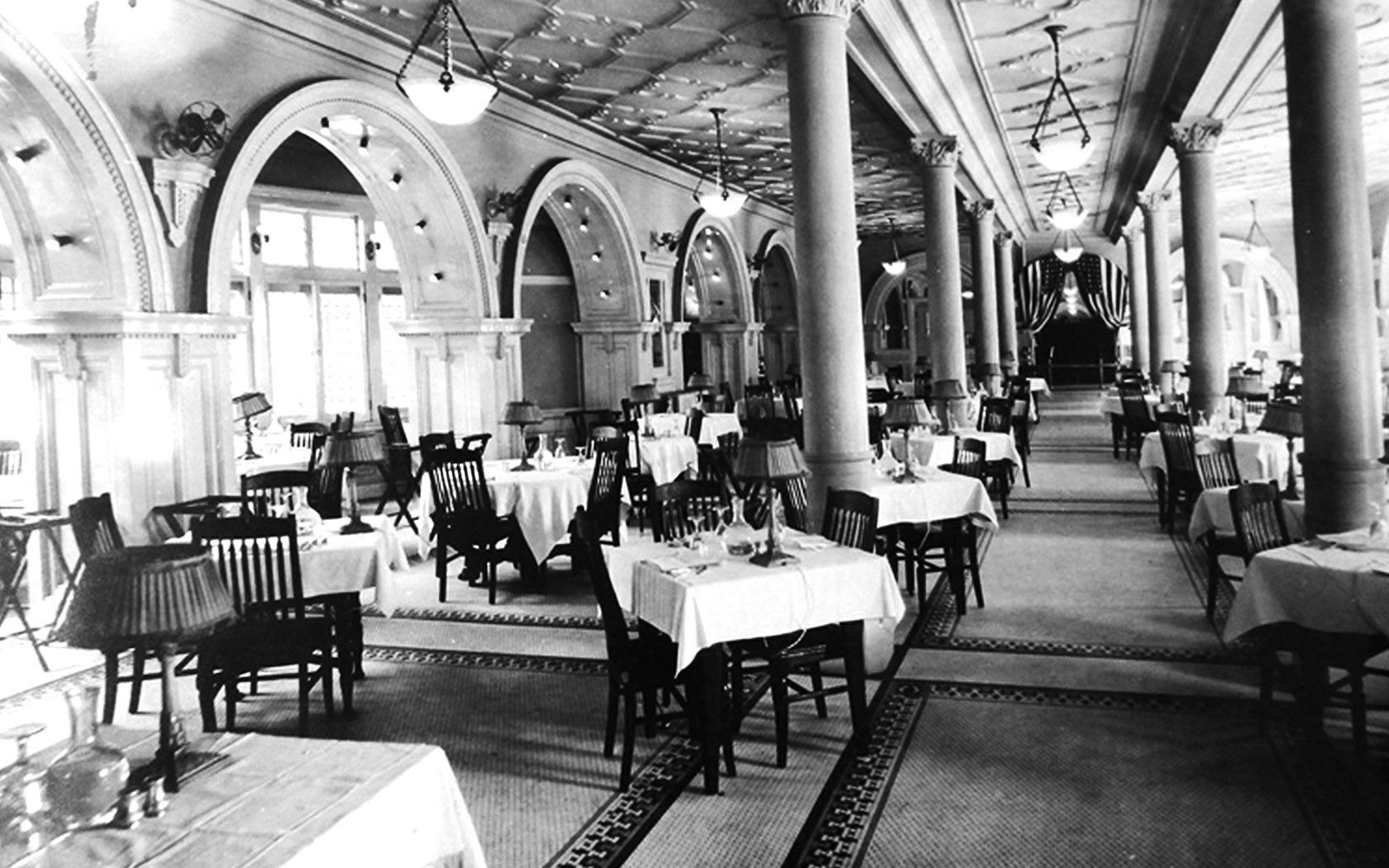 an old photograph of the dining area inside the hotel