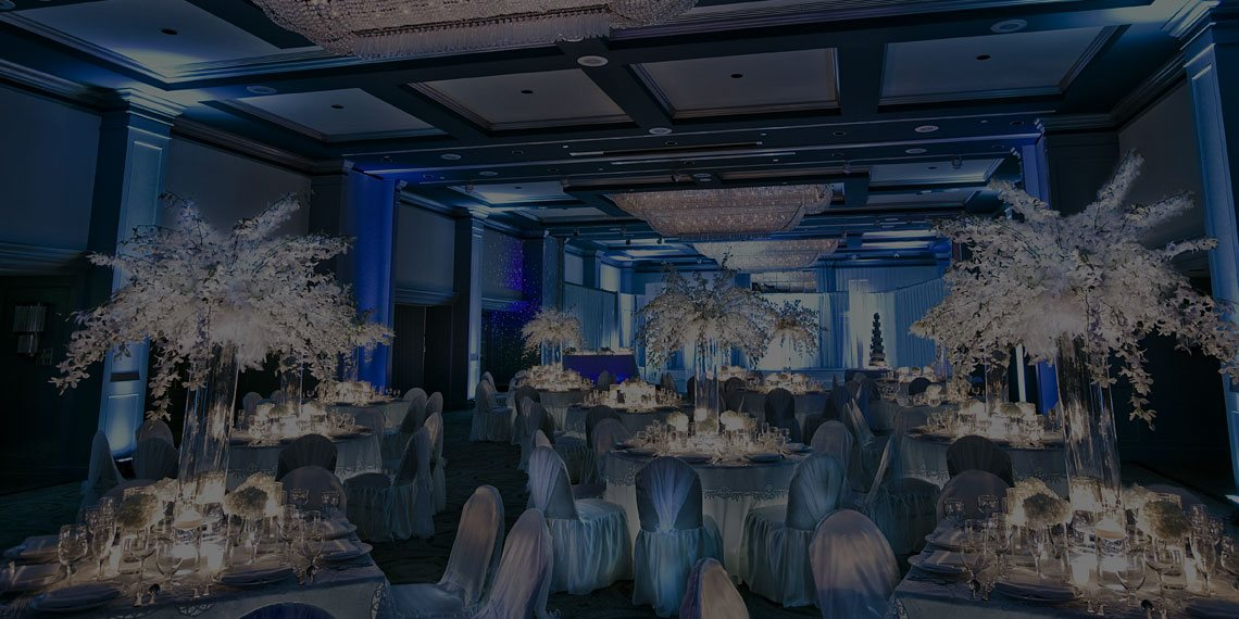 a ballroom set up for a blue themed event