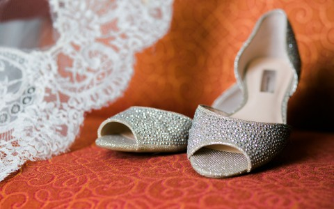 womens wedding shoes on a couch