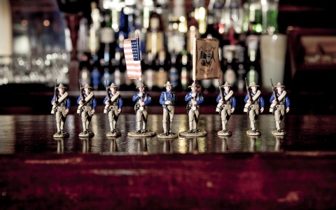 western figurines lined up on a bar