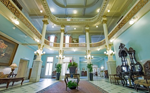 view of the lobby and seating area of menger hotel