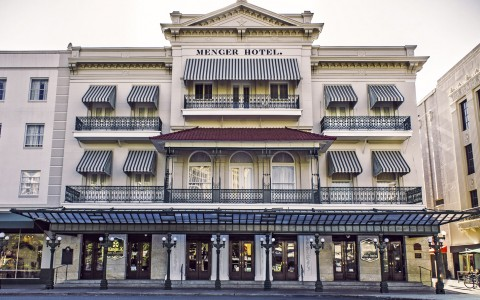 exterior of the menger hotel in the day time