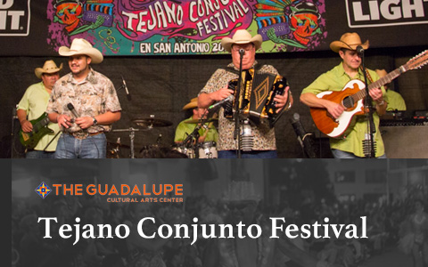 Four men in a band performing on stage all in cowboy hats. From left to right, the first man is playing guitar, second is holding a microphone, third is playing the accordion, and the fourth is playing the guitar. On the bottom of the image reads Tejano C