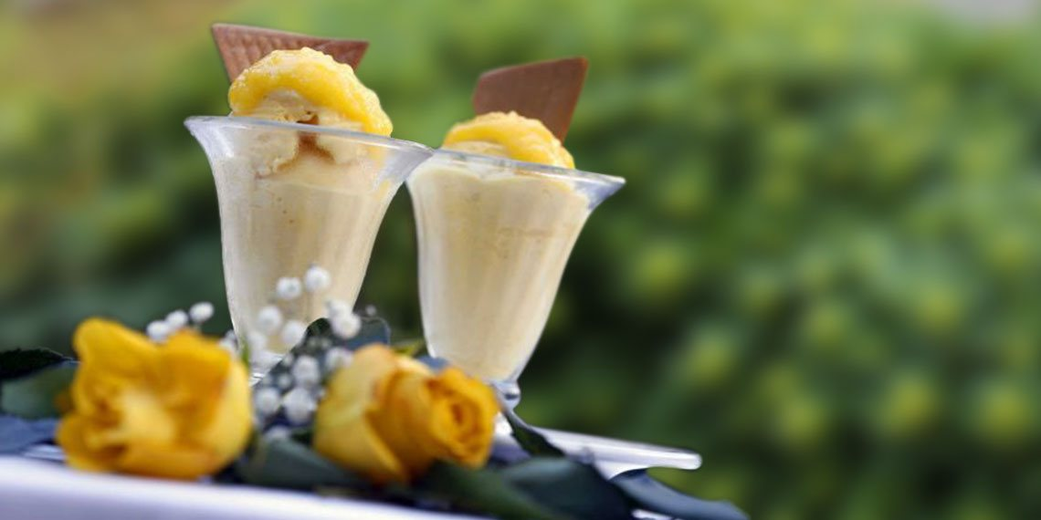 desserts next to yellow roses outside