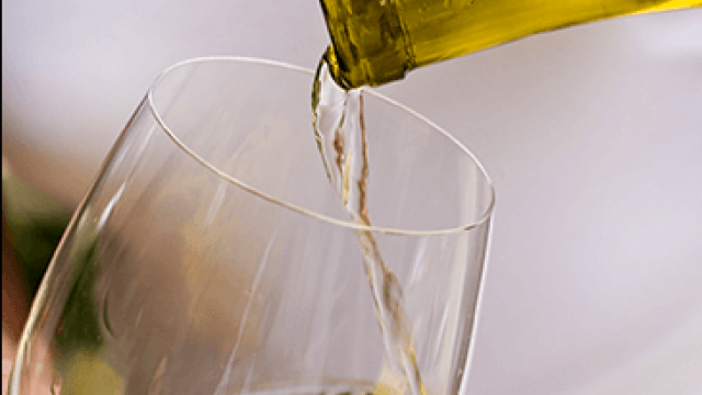 Chardonnay being poured into a wine glass