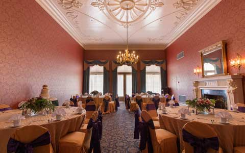Renaissance themed dining room with round tables and chairs