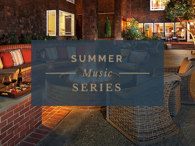 sign that states summer music series in front of whicker chairs