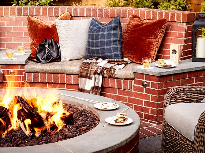 fire pit and s'mores next to brick seating area