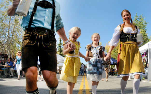 Oktoberfest Family in authentic Bavarian clothing, German Dirndl and Lederhosen