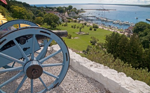 a cannon with a view down to the water
