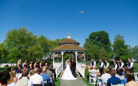 wedding taking place in front of a gazebo