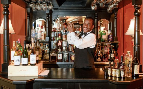 a man bartending behind the bar