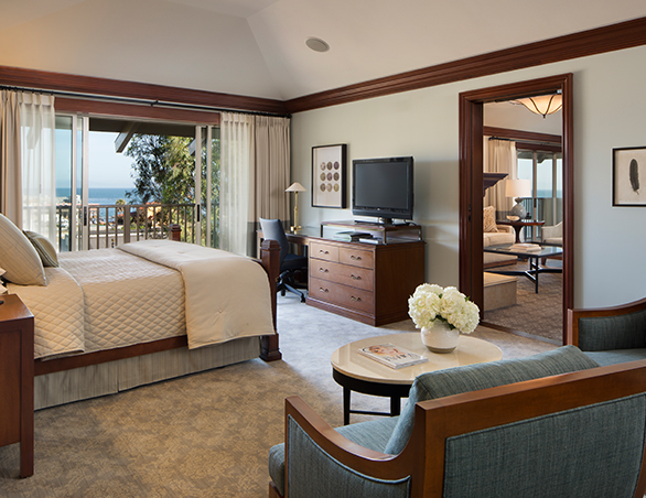 room with bed and ocean view