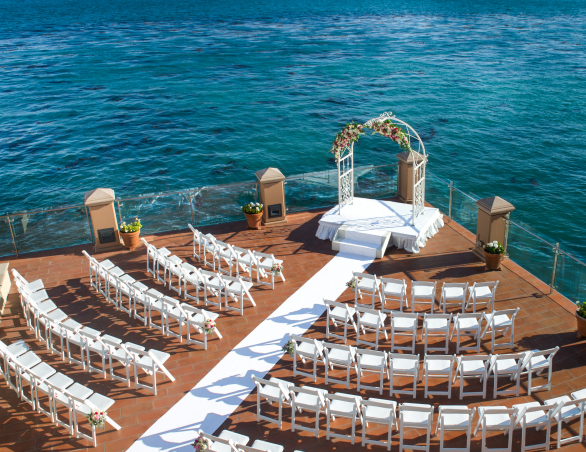 wedding ceremony set up on the outdoor terrace