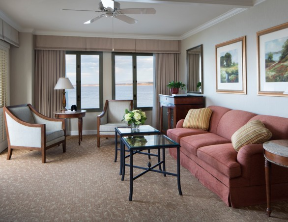 executive suite with seating area and large balcony overlooking the ocean