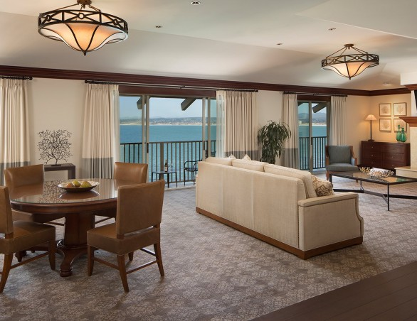 living area of the grand bay room with large balcony overlooking the ocean