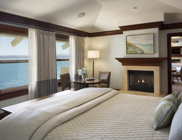 Spacious room with king bed overlooking the water