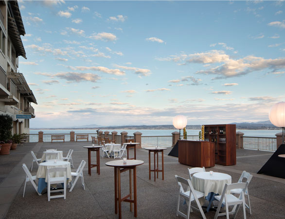 terrace overlooking the ocean set with cocktail tables
