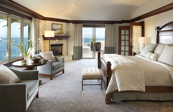 spacious bedroom with large bed overlooking the bay