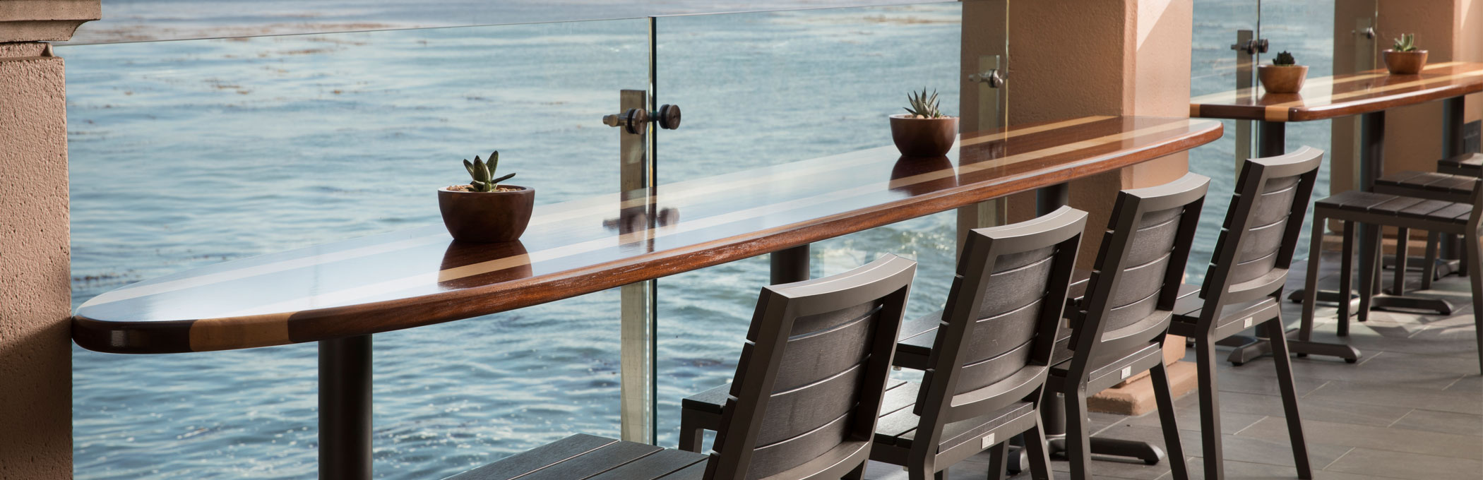 dining table overlooking the ocean on a terrace