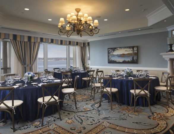 ocean club room set with round tables for a meeting
